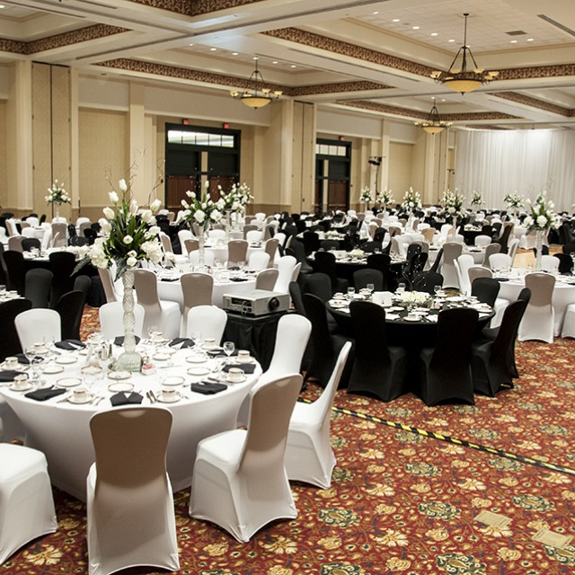 Image of the Grand Ballroom set for for the Mayors' Ball with black and white table linens.