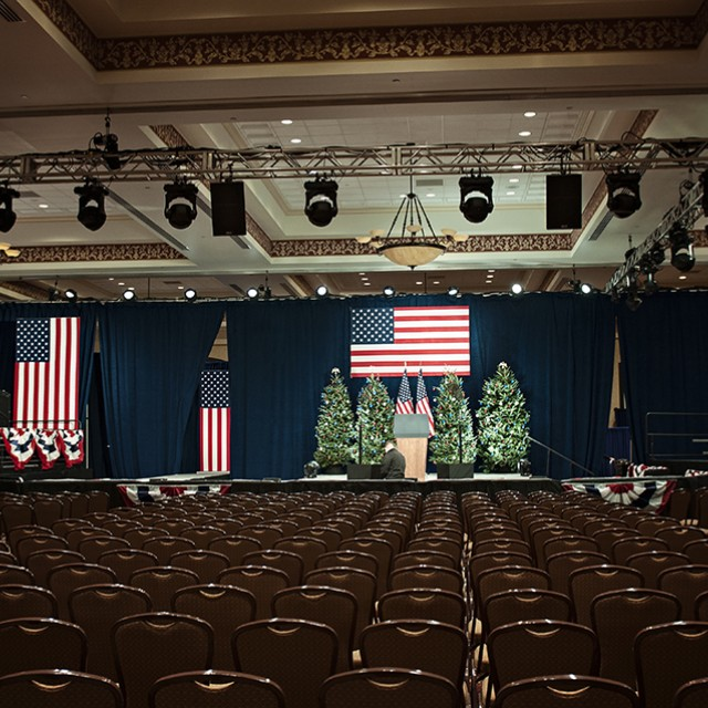 Image of the Grand Ballroom set theater style for an event hosting the President of the United States.