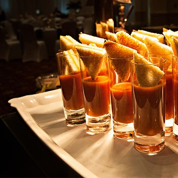 Image of grilled cheese and tomato soup shooters.